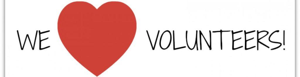"""Photo saying """"we heart (image) volunteers!"""