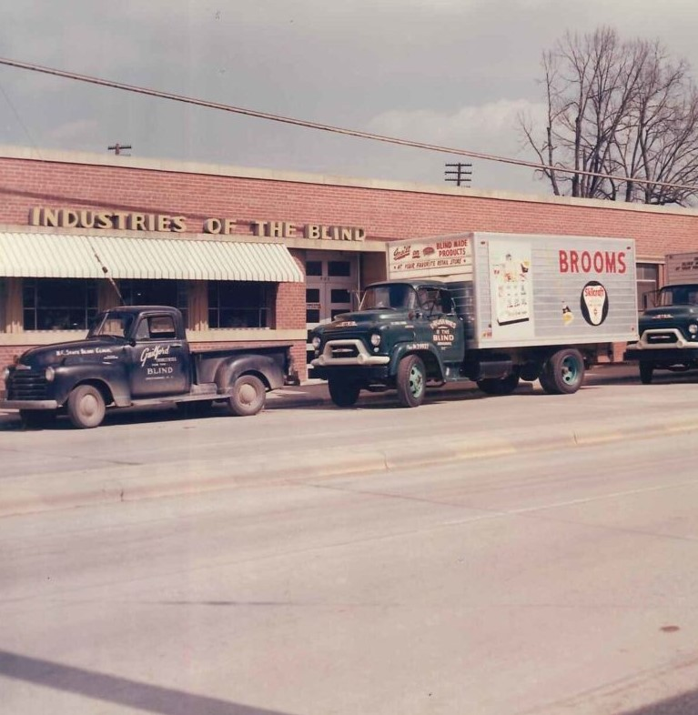 Old photo of street view of Industries of the Blind building when the building was one level in 1960's.
