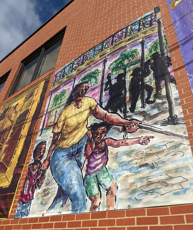 UNCG student Mary Martinez painted this scene of Afiya Jackson and her two children, walking down a New Orleans street.